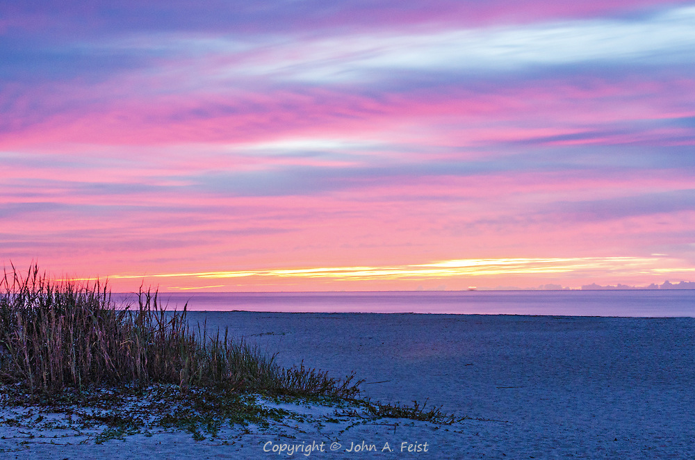 Dawn is just starting to break over the beach at Hilton Head.  These wonderful pastels light up the sky while the dune grass just enjoys the view