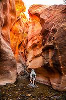 People hiking in a slot canyon en route to Kanarra Creek Falls near Cedar City, Utah USA