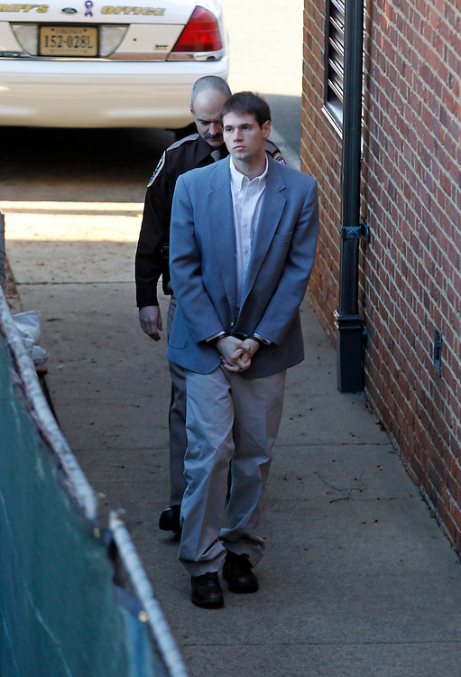 CHARLOTTESVILLE, VA - FEBRUARY 12: George Huguely is escorted to court as his trial in the death of former girlfriend Yeardley Love continues in Charlottesville, VA. Huguely was charged in the May 2010 death of his girlfriend Yeardley Love. She was a member of the Virginia women's lacrosse team. Huguely pleaded not guilty to first-degree murder. (Credit Image: © Andrew Shurtleff
