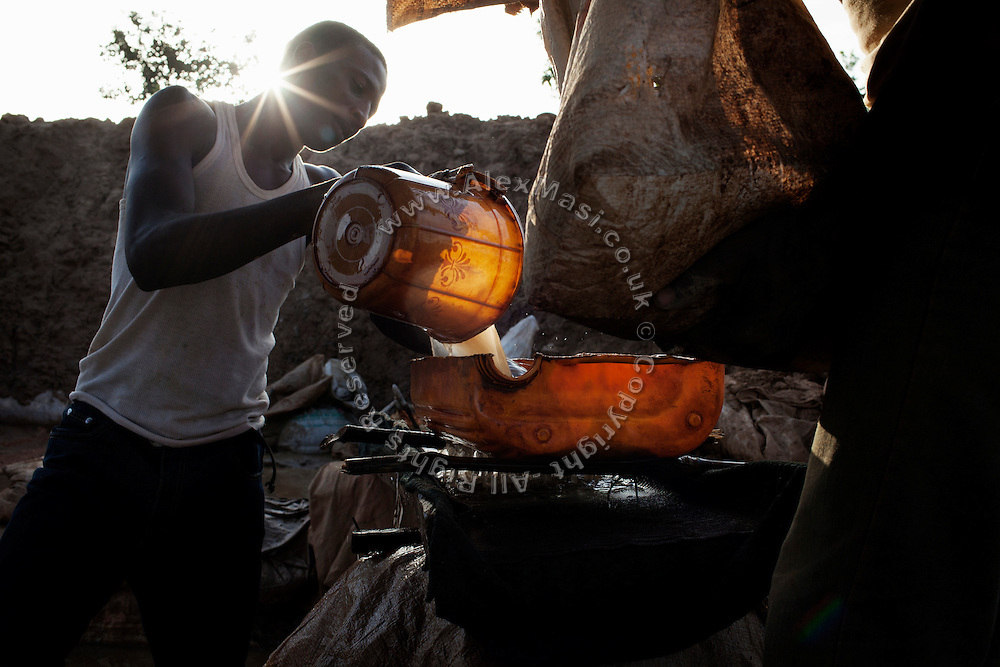 Workers are washing ore dust, separating gold sediments from other metals, to later collect it by mixing it with mercury, in an artisanal processing site near Bagega, pop. 9000, a large village affected by lead poisoning due to the unsafe techniques employed for extracting gold, in Zamfara State, Nigeria. The mercury recovered is then burned, revealing unpolished pieces of solid gold. It will be purified in Gusau, where goldsmiths will add sulphuric acid to refine the gold and remove all the impurities. The contamination is caused by ingestion and breathing of lead particles released in the steps to isolate the gold from other metals. This type of lead is soluble in stomach acid and children under-5 are most affected, as they tend to ingest more through their hands by touching the ground, and are developing symptoms often leading to death or serious disabilities.