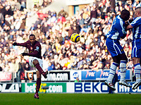 Photo: Jed Wee.<br />Wigan Athletic v Arsenal. The Barclays Premiership.<br />19/11/2005.<br />Arsenal's Thierry Henry fires in a freekick.