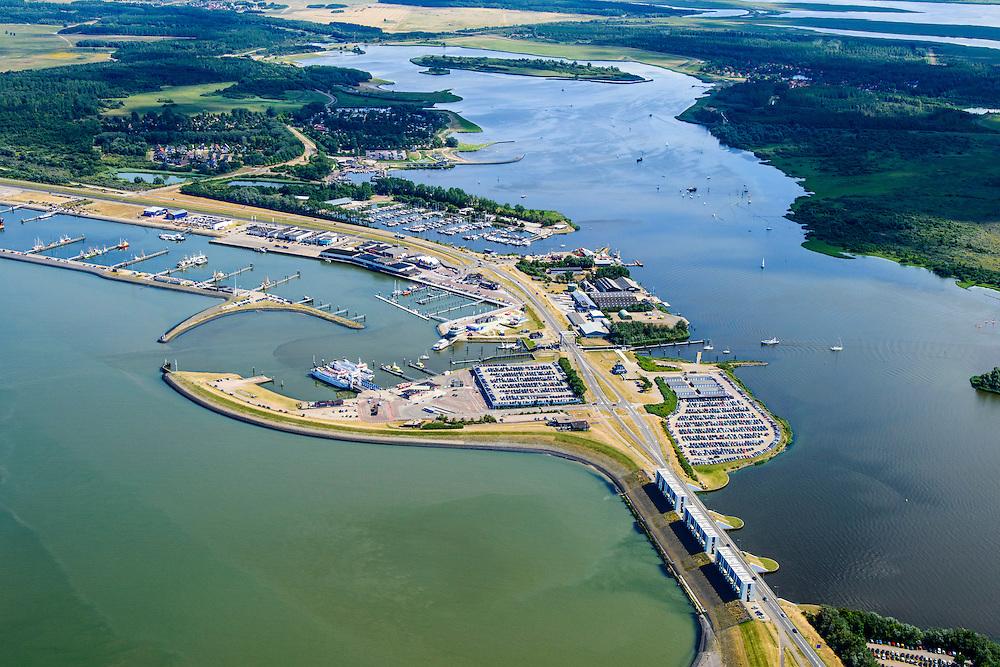 Nederland, Groningen, Gemeente de Marne, 05-08-2014; Lauwersoog met veerhaven voor veerdienst naar Schiermonnikoog. Rechts het Lauwersmeer (voormalige Lauwerszee) en de Lauwerssluizen, de  R.J. Cleveringsluizen. Deze spuisluizen zijn uitwaterende sluizen.<br /> Lauwers Lake, former Lauwers Sea on the border between Groningen and Friesland (north Netherlands).<br /> luchtfoto (toeslag op standard tarieven);<br /> aerial photo (additional fee required);<br /> copyright foto/photo Siebe Swart
