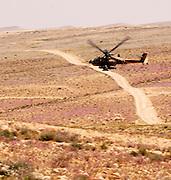 Israel, Negev, Israeli military helicopter flying over the negev desert