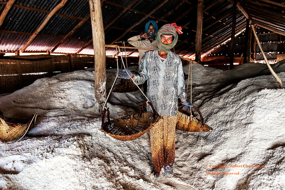 Salty Selfie: Salt workers pause for a photographic moment inside their warehouse, near Kampot Cambodia.
