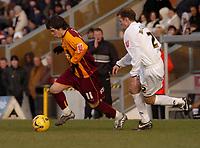 Photo: Ian Hebden.<br />Milton Keynes v Bradford City. Coca Cola League 1. 25/02/2006.<br />Bradfords Owen Morrison (L) takes on MK Dons Trent McClenahan (R)