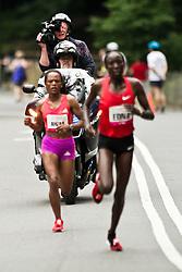 NYRR Mini 10K road race (40th year); TV cameraman follow leaders