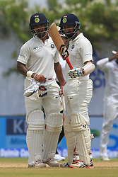 July 26, 2017 - Galle, Sri Lanka - Indian cricketer ..Cheteshwar Pujara(R) raises his bat after scoring 50 runs as his partner Shikhar Dhawan looks on during the 1st Day's in the 1st Test match between Sri Lanka and India at the Galle International cricket stadium, Galle, Sri Lanka on Wednesday 26 July 2017. (Credit Image: © Tharaka Basnayaka/NurPhoto via ZUMA Press)