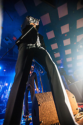 A wide angle upright shot from the photo pit of Nick Cave and violinist-cum-flautist Warren Ellis, of Nick Cave and the Bad Seeds, on stage tonight at The Barrowlands, Glasgow, Scotland.<br /> ©Michael Schofield.