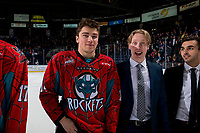 KELOWNA, CANADA - MARCH 16: Cole Carrier #12 and Lassi Thompson #2 of the Kelowna Rockets line up for the shirt off your back presentation after the OT win against the Vancouver Giants on March 16, 2019 at Prospera Place in Kelowna, British Columbia, Canada.  (Photo by Marissa Baecker/Shoot the Breeze)