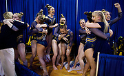 The Michigan Women's Gymnastics team reacts after advancing to the National Championship at the Ann Arbor Regional at Crisler Center on April 6, 2019 in Ann Arbor, Michigan. Michigan advanced over Alabama with a score of 197.275 to 197.225.