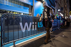 © licensed to London News Pictures. London, UK 29/11/2012. A cosplayer walking past the queue for the launch of Nintendo's latest gaming console, Wii U at HMV Store in Oxford Street, London. Photo credit: Tolga Akmen/LNP
