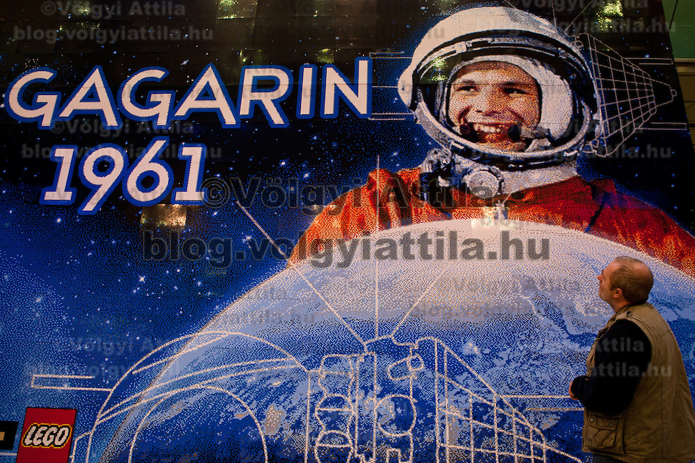 Visitor looks at world record breaker mosaic image of Russian astronaut Yuri Gagarin in Budapest, Hungary on March 27, 2011..The 30 square meters large mosaic image is made up from 470 016 Lego pieces and was built to celebrate the 50th anniversary of the first space flight. The national record is alredy validated and the international Guinness Record validation is in progress. ATTILA VOLGYI