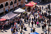 29 MAY 2021 - DES MOINES, IOWA: The Des Moines Farmers Market full reopened this Saturday with prepared food vendors and buskers. The Des Moines Farmers Market is the largest weekly Farmers Market in Iowa. The market was largely cancelled in 2020 because of COVID-19 pandemic, but reopened in a limited way in 2021. In order to comply with Coronavirus safety guidelines, traffic is one way past the stands and people are required to wear face masks. Traditionally about 25,000 people attended the Saturday morning market, and about 40,000 people attended market on the opening day, the first Saturday in May. This year there will be about 115 vendors, 75% the normal number of vendors. As the CDC rolls back Coronavirus guidelines, the market is expanding. The market will expand Memorial Day weekend to include prepared food stands and children's activities.             PHOTO BY JACK KURTZ