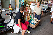 Street vendor selling garlic in the area along Athinas near to the Athens Central Market near Omonia. Athens is the capital and largest city of Greece. It dominates the Attica periphery and is one of the world's oldest cities, as its recorded history spans around 3,400 years. Classical Athens was a powerful city-state. A centre for the arts, learning and philosophy.
