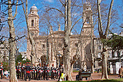 A military parade on the Plaza Constitucion Constitution Square dressed in old style uniforms and carrying sabres. In front of the Iglesia Matriz Church Montevideo, Uruguay, South America