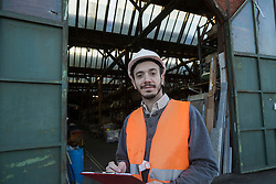 Portrait of a young male engineer working at construction site, Freiburg Im Breisgau, Baden-Wuerttemberg, Germany