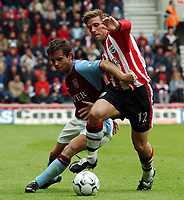 Picture: Henry Browne, Digitalsport<br /> NORWAY ONLY<br /> <br /> Date: 08/05/2004.<br /> Southampton v Aston Villa FA Barclaycard Premiership.<br /> <br /> Lee Hendrie of Villa battles with Saints' Anders Svensson.