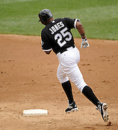 CHICAGO - JULY 11:  Andruw Jones #25 of the Chicago White Sox rounds second base after hitting his 400th career home run off of Anthony Lerew #54 of the Kansas City Royals in the third inning on July 11, 2010 at U.S. Cellular Field in Chicago, Illinois.  The White Sox defeated the Royals 15-5.  (Photo by Ron Vesely)