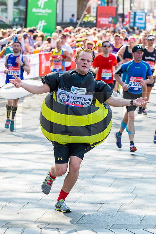 © Licensed to London News Pictures. 22/04/2018. London, UK. A runner in fancy dress passes the Cutty Sark in Greenwich during the Virgin Money London Marathon 2018. Photo credit: Rob Pinney/LNP