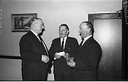 07/02/1964<br /> 02/07/1964<br /> 07 February 1964<br /> Esso staff presentations in Esso premises at Alexandra Road, Dublin. Presentations made by Mr Denis Dunne (left), Director at Esso Petroleum Company (Ireland) Ltd.