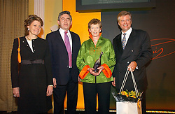 Left to right,  CECILE BONNEFOND President of Veuve Clicquot Ponsardin, the RT.HON.GORDON BROWN MP   winner of the 2006 Veuve Clicquot Award VIVIENNE COX, and DAVID MEYERS MD Moet Hennessy UK Ltd at a reception for the winners of the 2006 Veuve Clicquot Award - Business Woman of the Year held at Claridge's Hotel, brook Street, London on 27th April 2006.  This years winner was Vivienne Cox, BP CEO for Gas, Power, Renewables and Integrated Supply & Trading.  The awards were presented by the Rt.Hon.Gordon Brown MP - The Chancellor of the Exchequer.<br />