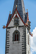Dragon gargoyles decorate the rain spouts on the steeple of the Stadtkirche (City Church) in Stein am Rhein, a well-preserved medieval center in Schaffhausen Canton, Switzerland, Europe. The legend of St. George slaying a dragon was a brought back with the Crusaders. According to legend, St. George (who may have lived about AD 280-303) was a Roman soldier of Greek origin and officer in the Guard of Roman emperor Diocletian, who ordered his death for failing to recant his Christian faith. As a Christian martyr, he later became one of the most venerated saints in Christianity.