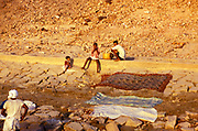 Laundry laid out of rocks to dry River Ganges, Varanasi, India 1974