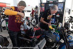 Cris and Pat Simmons at a gas / oil stop on the Motorcycle Cannonball coast to coast vintage run. Stage 7 (274 miles) from Cedar Rapids to Spirit Lake, IA. Friday September 14, 2018. Photography ©2018 Michael Lichter.