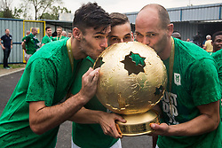 Rok Kronaveter of NK Olimpija, Nik Kapun of NK Olimpija and Aris Zarifovic of NK Olimpija celebrate with a trophy after they became Slovenian National Champion 2018 after the football match between NK Domzale and NK Olimpija Ljubljana in 36th Round of Prva liga Telekom Slovenije 2017/18, on May 27, 2018 in Sports park Domzale, Domzale, Slovenia. Photo by Vid Ponikvar / Sportida