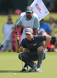 September 21, 2017 - Atlanta, GA, USA - Webb Simpson looks over his par putt on the 1st green in the opening round of the Tour Championship on Thursday, Sept. 21, 2017, at Eastlake Golf Club in Atlanta. (Credit Image: © Curtis Compton/TNS via ZUMA Wire)