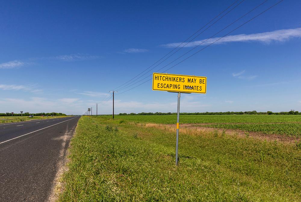 Hitchhikers may be escaping inmates sign. Between Hondo and Sabinal, Texas, USA