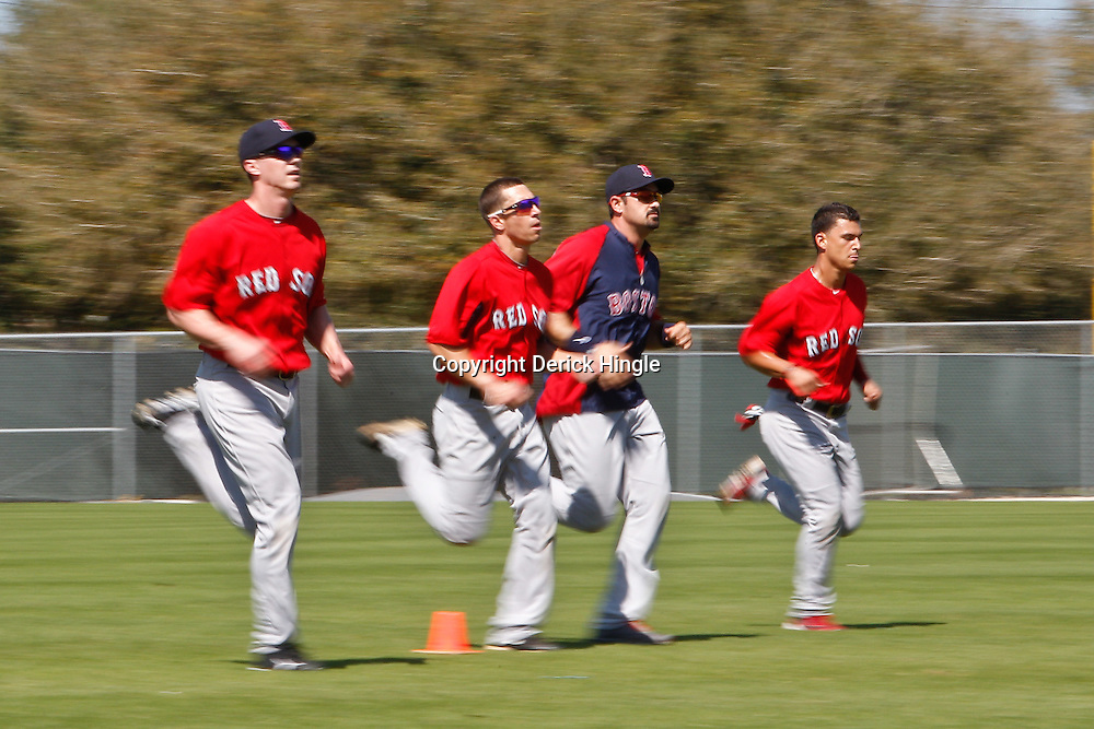 February 19, 2011; Fort Myers, FL, USA; Boston Red Sox players run wind springs at the end of practice during spring training at the Player Development Complex.  Mandatory Credit: Derick E. Hingle