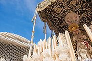 A float carrying the Virgin Mary, passes next to the contemporary architecture of the Encarnation Market in Plaza de la Encarnacion in Seville. Andalusia, Spain