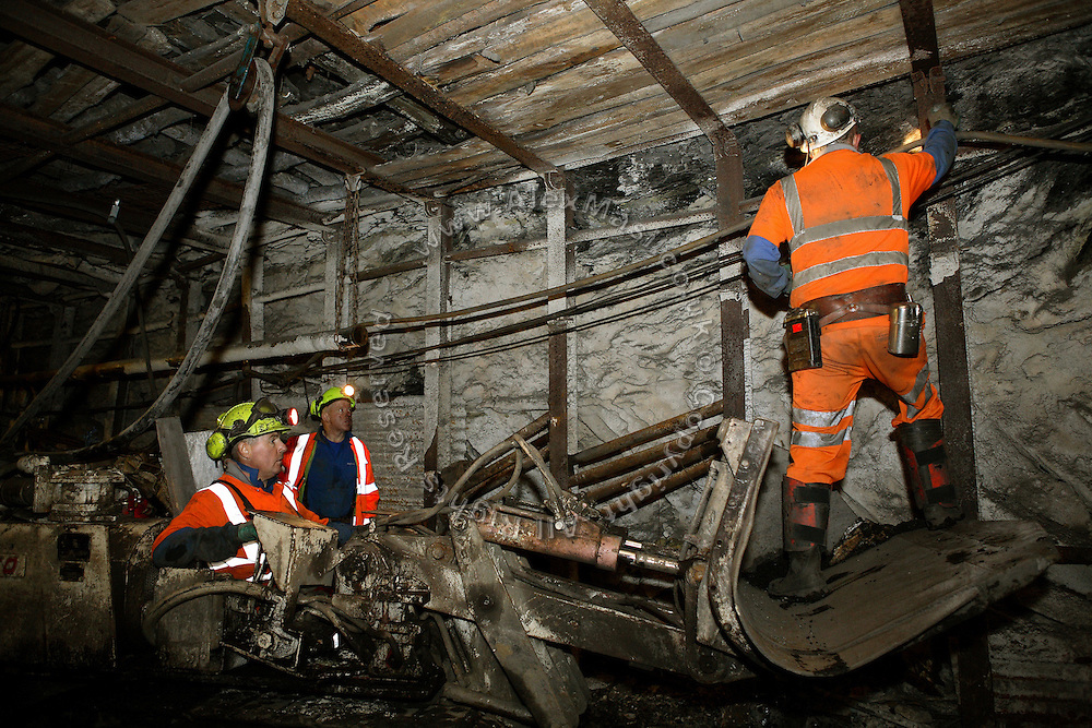 Miners are inspecting the underground coal wall at the Unity Mine complex, on Tuesday, July 31, 2007, in Cwmgwrach, Vale of Neath, South Wales. The time is ripe again for an unexpected revival of the coal industry in the Vale of Neath due to the increasing prize and diminishing reserves of oil and gas, the uncertainties of renewable energy sources, and the technological advancement in producing energy from coal while limiting emissions of pollutants, has created the basis for valuable investment opportunities and a possible alternative to the latest energy crisis. Unity Mine, in particular, has started a pioneering effort to revive the coal industry in the area, reopening after more than 8 years with the intent of exploiting the large resources still buried underground. Coal could be then answer to both, access to cheaper and paradoxically greener energy and a better and safer choice than nuclear energy as a major supply for the decades to come. It is estimated that coal reserves in Wales amount to over 250 million tonnes, or the equivalent of at least 50 years of energy supply, while the worldwide total coal could last for over 200 years as a viable resource compared to only a few decades of oil and natural gas...