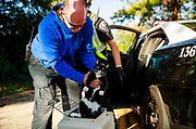 """BPD animal control officer James Pritchard puts a cat named Abby into a carrier at the scene of a house fire. Bloomington firefighters respond to a fire in a house in the 1500 block of W. 11th Street, Saturday, Oct., 12, 2019 in Bloomington, Ind. David Clark, who lives in the house, said he was cooking, and had oatmeal and beans on the stove when he noticed smoke coming from the ceiling above him, and a few seconds later there was a knock from the fire department, who had been called. Clark, and firefighters rescued an adult cat, and a kitten, two of three cats in the house. One kitten hid. A cat named Abby, and a kitten stayed warm in the back of a Bloomington Police Department cruiser until animal control arrived with carriers for the animals. """"I just thank god I was home and awake,"""" said Clark. """"It could have gone undetected."""" Firefighters were called at 8:48 a.m. and arrived at 8:52 to find an attic fire in the rear of the house, said Bloomington Fire Department Capt, and acting Battalion Chief, Danny Gillespie. Firefighters quickly knocked down the fire, and had it under control in 7 minutes. An investigator was enroute to determine the cause and origin of the fire. There were no injuries. First responders from IU Health, Bloomington Fire Dept., Animal Control, Duke, and Red Cross were on the scene. Clark said he hopes to only be out of his home for a few days, or weeks for repairs, because he really likes the home, which is affordable, and in a part of town that's convenient for him."""