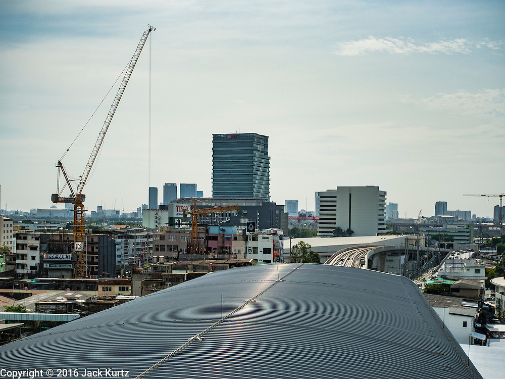 """23 AUGUST 2016 - NONTHABURI, NONTHABURI, THAILAND:  The not yet completed connection between the """"Blue Line"""" and """"Purple Line"""" commuter light rail in the Tao Poon station in Bangkok. The """"Purple Line"""" is the new Bangkok commuter rail line that runs from Bang Sue, in Bangkok, to Nonthaburi, a large Bangkok suburb. The Purple Line is run by the  Metropolitan Rapid Transit (MRT) which operates Bangkok's subway system. The Purple Line is the fifth light rail mass transit line in Bangkok and is 23 kilometers long. The Purple Line opened on August 6 and so far ridership is below expectations. Only about 20,000 people a day are using the line; officials had estimated as many 70,000 people per day would use the line. The Purple Line was supposed to connect to the MRT's Blue Line, which goes into central Bangkok, but the line was opened before the connection was completed so commuters have to take a shuttle bus or taxi to the Blue Line station. The Thai government has ordered transit officials to come up with plans to increase ridership. Officials are looking at lowering fares and / or improving the connections between the two light rail lines.    PHOTO BY JACK KURTZ"""