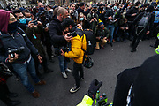 """British Asian photographer Ayush Pachnanda is seen suffering consequences of pepper spray used by a member of the MET Police forces who appeared to target multiple members of the press and other photographers while they were trying to push protesters who were blocking a McDonald's lorry outside the houses of parliament during a """"Kill the Bill"""" protest in London on Saturday, April 3, 2021."""