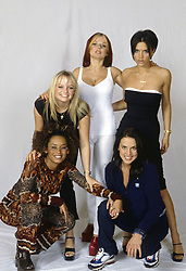 British girl band The Spice Girls posing on a photo set. The band is formed by British singer-songwriter and writer Geri Halliwell, British singer-songwriter Melanie C (Melanie Chisholm), British singer and actress Mel B (Melanie Janine Brown), British singer, fashion designer and model Victoria Beckham (Victoria Adam) and British singer-songwriter and TV presenter Emma Bunton. 1998 (Credit Image: © Rino Petrosino/Mondadori Portfolio via ZUMA Press)