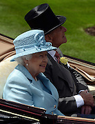 © Licensed to London News Pictures. 19/06/2012. Ascot, UK  HRH Queen Elizabeth II and HRH The Duke of Edinburgh. The Royal Procession enter the parade ring on Day one at Royal Ascot 19 June 2012. Royal Ascot has established itself as a national institution and the centrepiece of the British social calendar as well as being a stage for the best racehorses in the world.. Photo credit : Stephen Simpson/LNP