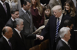 January 21, 2017 - Washington, DC, U.S. - U.S President DONALD TRUMP greets attendees during the National Prayer Service at the National Cathedral in Washington on Saturday. Trump began his first full day in office at the service, where clergy members of many faiths urged him to embrace peace and compassion. (Credit Image: © Olivier Douliery/Pool/CNP via ZUMA Wire)