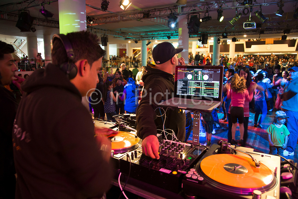 DJ performs for people dancing to Asian music during Alchemy, Southbank Centre's annual festival showcasing the best of music, dance, literature, comedy, fashion, art and design from the UK and South Asia. The South Bank is a significant arts and entertainment district, and home to an endless list of activities for Londoners, visitors and tourists alike.