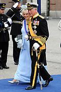De gasten en koninklijk paar verlaten de kerk na de inhuldiging, Nieuwe Kerk in Amsterdam. <br /> <br /> Guest and Royal couple leave after the inauguration at the Nieuwe Kerk in Amsterdam. <br /> <br />  Camilla Duchess of Cornwall and Prince Charles