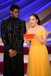 Constance Wu and Chadwick Boseman present the Oscar® for achievement in music written for motion pictures (original song) during the live ABC Telecast of The 91st Oscars® at the Dolby® Theatre in Hollywood, CA on Sunday, February 24, 2019.