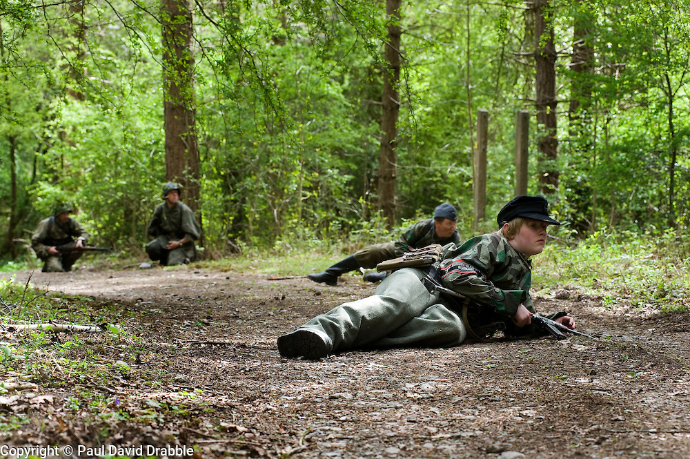 Reenactors from Northern World War Two Association, dressed as elements of the Elite Gross Deutschland Division pinned down on a dirt road by allied fire during a private 24hr excerise, held at Sutton Grange, near Ripon in Yorkshire 15  May 2010 .Images © Paul David Drabble.