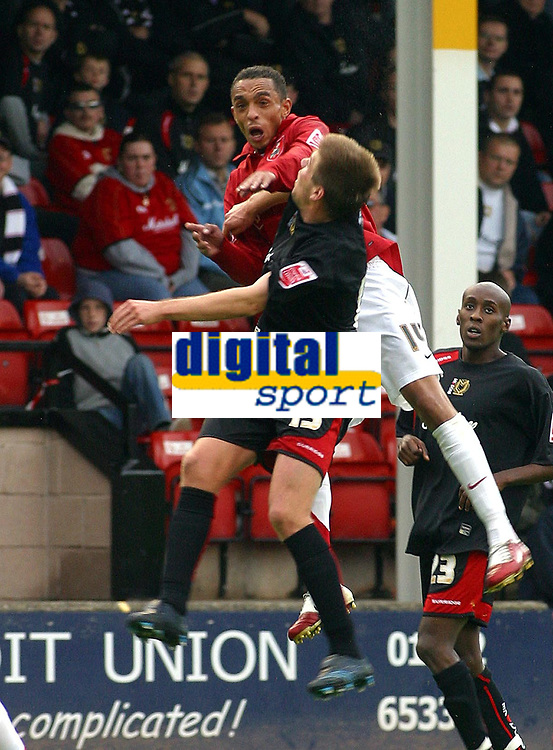 Photo: Dave Linney.<br />Walsall v Milton Keynes Dons. Coca Cola League 2. 28/10/2006 Walsall's Mark Wright(L) in an aerial dual with  Gareth Edds.