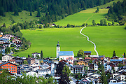 Swiss scene church and village of Flims in mountain pass in the Graubunden region of Switzerland