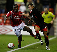 Photo: Steve Bond/Richard Lane Photography. Nottingham Forest v Doncaster Rovers. Coca Cola Championship. 28/11/2009. Wes Morgan (L) and Billy Sharp chase down the ball