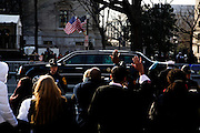 The Inauguration of President Barack Obama. Washington DC, January 20, 2009. A presidential limousine, appearing to carry Barack Obama, speeds to the Capitol building before the start of the Inauguration ceremony.