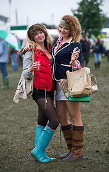© Licensed to London News Pictures. 10/07/2012..Harrogate, England...Jeska Bailey, 20 at left and sarah Watson, 20 from York enjoy the first day of the great Yorkshire Show...England's premier agricultural show opened it's gates today for the start of three days of showcasing the best in British farming and the countryside...The event, which attracts over 130,000 visitors each year is the 154th show and displays the cream of the country's livestock and offers numerous displays and events and gives the chance to see many different countryside activities...Photo credit : Ian Forsyth/LNP