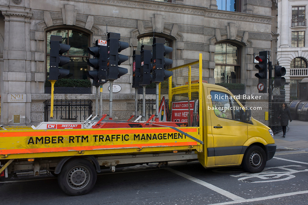 A lorry belonging to traffic management contractor Amber-RTM, delivering traffic lights but stopped at its own red lights in the City of London. Amber-RTM Limited is a UK based, privately owned independent professional company providing a complete temporary road traffic management solution nationally on a 24/7-365day basis.